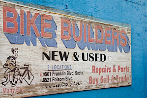 vintage bike builders flea market sign on a blue wall