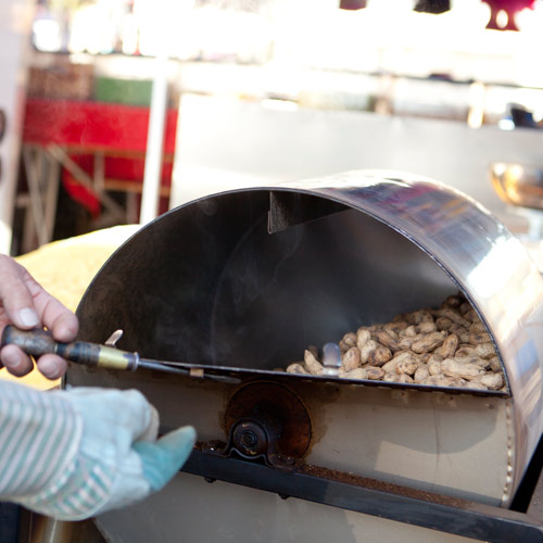 a vendor roasting peanuts at Folsom Boulevard Flea Market